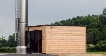 Viele Kommunen in Deutschland setzen mittlerweile auf Holzhackschnitzelanlage in Neubaugebieten.