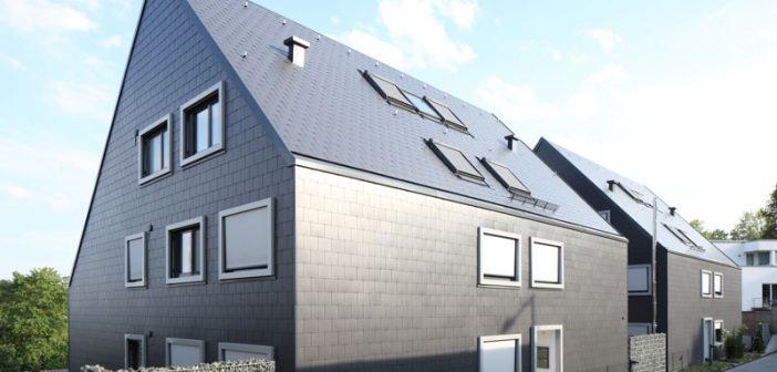 Mehrfamilienhäuser in Leonberg: Die Doppeldeckung aus blauschwarzen Dachplatten 32/60 ermöglicht eine exakte Detailausbildung mit scharfkantigen, überstandslosen Gebäudekanten und betont die homogene, geschlossene Form der beiden Baukörper.